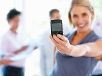 bigstock_Woman_Holding_Cell_Phone_11703362